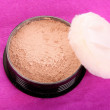 Makeup powder on pink background — Stock Photo #6680027