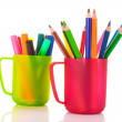Many colorful pencils in the cup on the white background — Stock Photo
