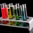 Test tubes on black background — Stock Photo