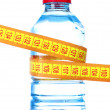 Yellow tape measure and water bottle — Stock Photo #6680387