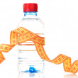 Yellow tape measure and water bottle — Stock Photo #6680392