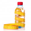 Yellow tape measure and water bottle — Stock Photo