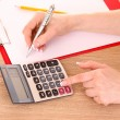 Stock Photo: Writing and calculator