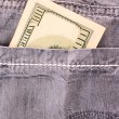 Dollar bank note  in the jeans pocket — 图库照片