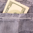 Dollar bank note  in the jeans pocket — Stock fotografie