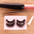 False lashes and mascara   on the table — Stock Photo