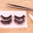 False lashes    on the table — Stok fotoğraf