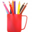 Many colorful pencils in the cup on the white background — Stock Photo #6686212