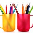 Many colorful pencils in the cup on the white background — Stock Photo #6686253