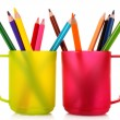 Many colorful pencils in the cup on the white background — Stock Photo #6686254