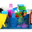 Cleaning supplies in basket on white background - Stock Photo