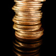 Coins on black background — Stock Photo