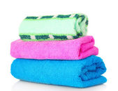 Stacked bathroom towels on a white background — Stock Photo