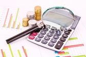 Business chart showing financial success, glasses and calculator — Stock Photo