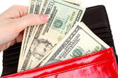 Red purse with dollars in the hands on a white background — Stock Photo