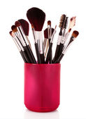Cosmetic brushes in cup white — Stock Photo
