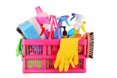Cleaning supplies in basket on white background — Stock Photo