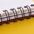 Notebook with pencil on the yellow background — Stock Photo