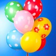 Flying balloons with polka dot on a blue background - Foto Stock