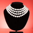 Pearl necklace on black mannequin — Stock Photo