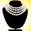 Pearl necklace on black mannequin — Stock Photo #6709945