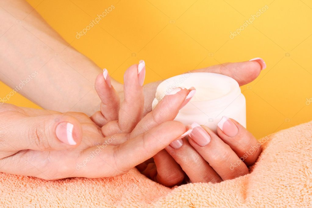 Woman applying cream on her hand  Stock Photo #6708624