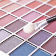 Big eye shadow kit and applicator — Stock Photo