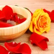 Постер, плакат: Red rose petals in and around bowl of water