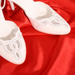 Closeup of fashionable bridal wedding shoes - Stock Photo