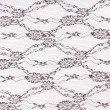 Stock Photo: Black lace with pattern on white background
