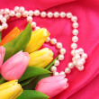 Smooth elegant red silk background with pearls — Stock Photo