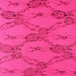 Black lace with pattern on pink background — Stock Photo