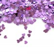 Violet hearts  in the form of confetti on white - Zdjcie stockowe