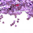 Violet hearts in the form of confetti on white — Stock Photo