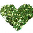 Green hearts  in the form of confetti on white - Stockfoto