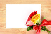 A bunch of roses with a greeting card — Stock Photo