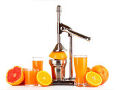 Juicer and oranges on white background — Stock Photo