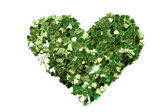 Green hearts in the form of confetti on white — Stock Photo