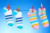 Bright striped socks on line — Stock Photo