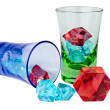 Wineglasses with colored ice pieces — Stock Photo