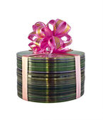 Stack of CD disks with pink gift lace over white — Stock Photo
