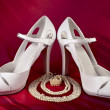 Stock Photo: White high-heeled shoes and pearls