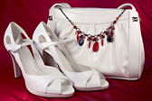 White high-heeled shoes and handbag — Стоковое фото
