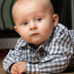 6 months male child sitting on floor — Stock Photo #6743054