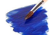 Slick blue paint with a brush — Stock Photo