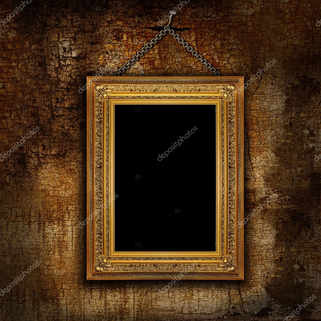 Frame of the painting hanging on a chain on a cracked wall — Stock Photo #6684575