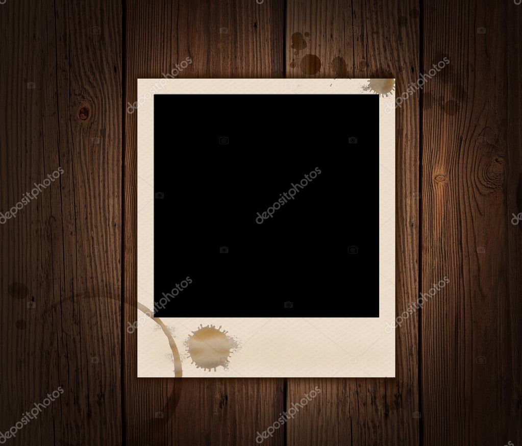 Picture on an old wooden substrate with patches of tea — Stock Photo #6685721