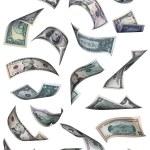 Different dollar bills falling — Stock Photo