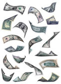 Different dollar bills falling — Stock Photo