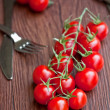 Cherry tomatoes on wooden table — Stock Photo #6701731
